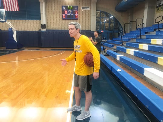 TCC acting head coach Zach Settembre observes the action in practice. He will lead the team for the remainder of the season.