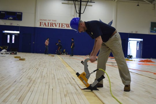 Leon County Schools Superintendent Rocky Hanna helps nail the gym floor Thursday, Jan. 24, 2019, at Fairview Middle School. The gym is being updated as part of a $20-million renovation project.