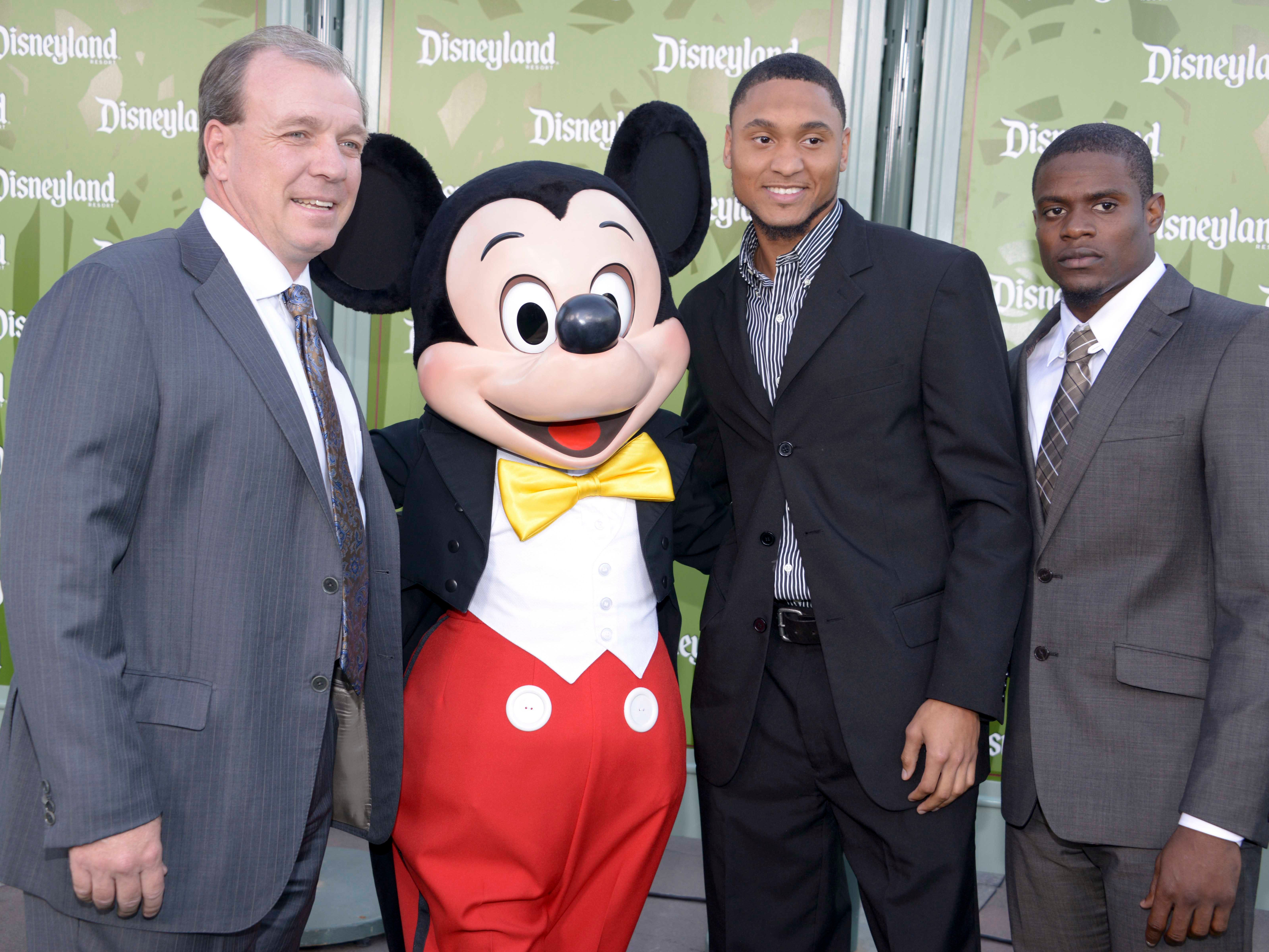 Dec 31, 2013; Anaheim, CA, USA; Florida State Seminoles coach Jimbo Fisher (left) poses with Mickey Mouse (second from left) and receiver Rashad Greene (second from right) and defensive back Lamarcus Joyner at a press conference for the 2014 BCS National Championship at ESPN Zone Downtown Disney. Mandatory Credit: Kirby Lee-USA TODAY Sports