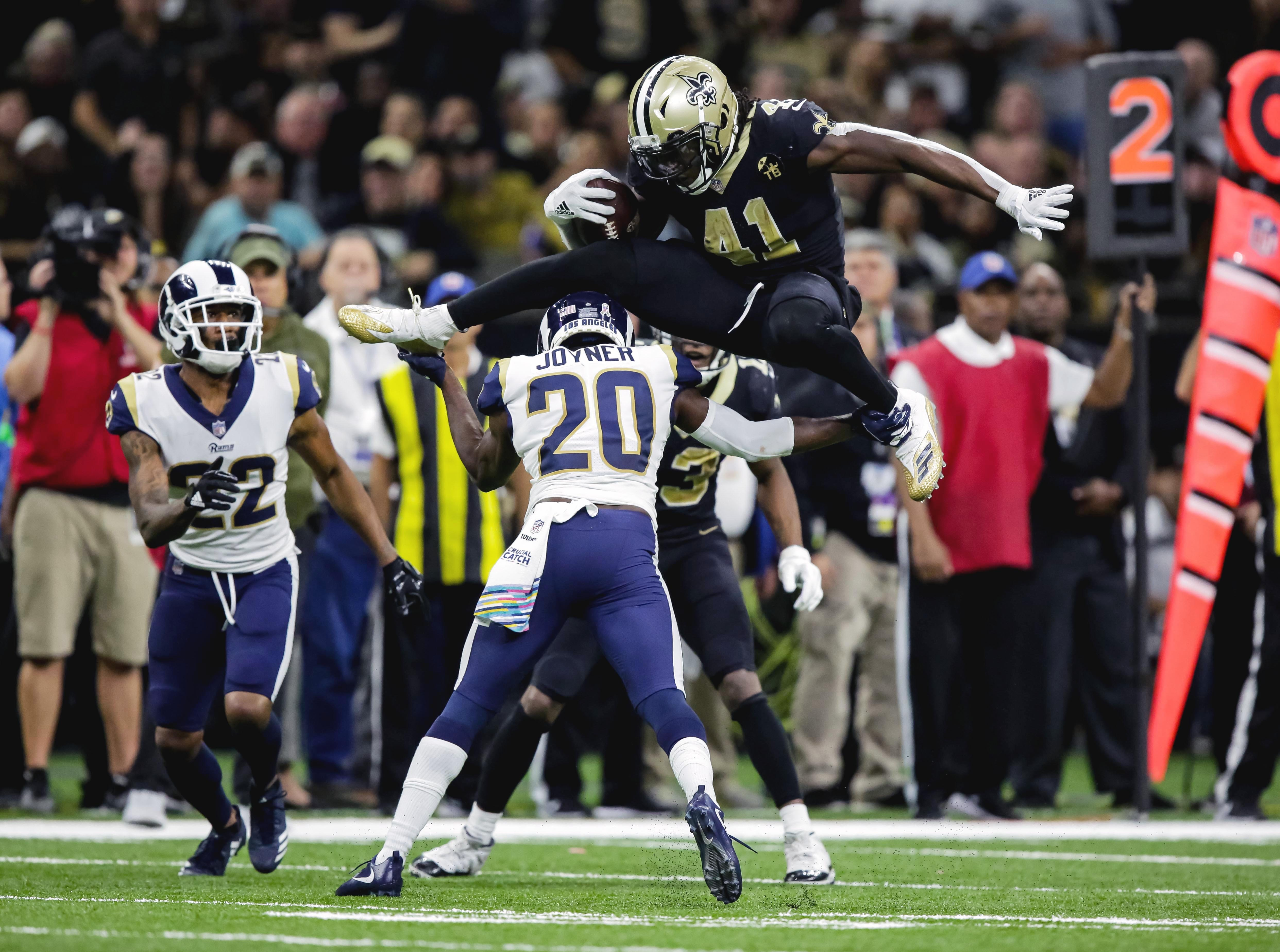 Nov 4, 2018; New Orleans, LA, USA; New Orleans Saints running back Alvin Kamara (41) hurdles over Los Angeles Rams free safety Lamarcus Joyner (20) during the fourth quarter at the Mercedes-Benz Superdome. Mandatory Credit: Derick E. Hingle-USA TODAY Sports