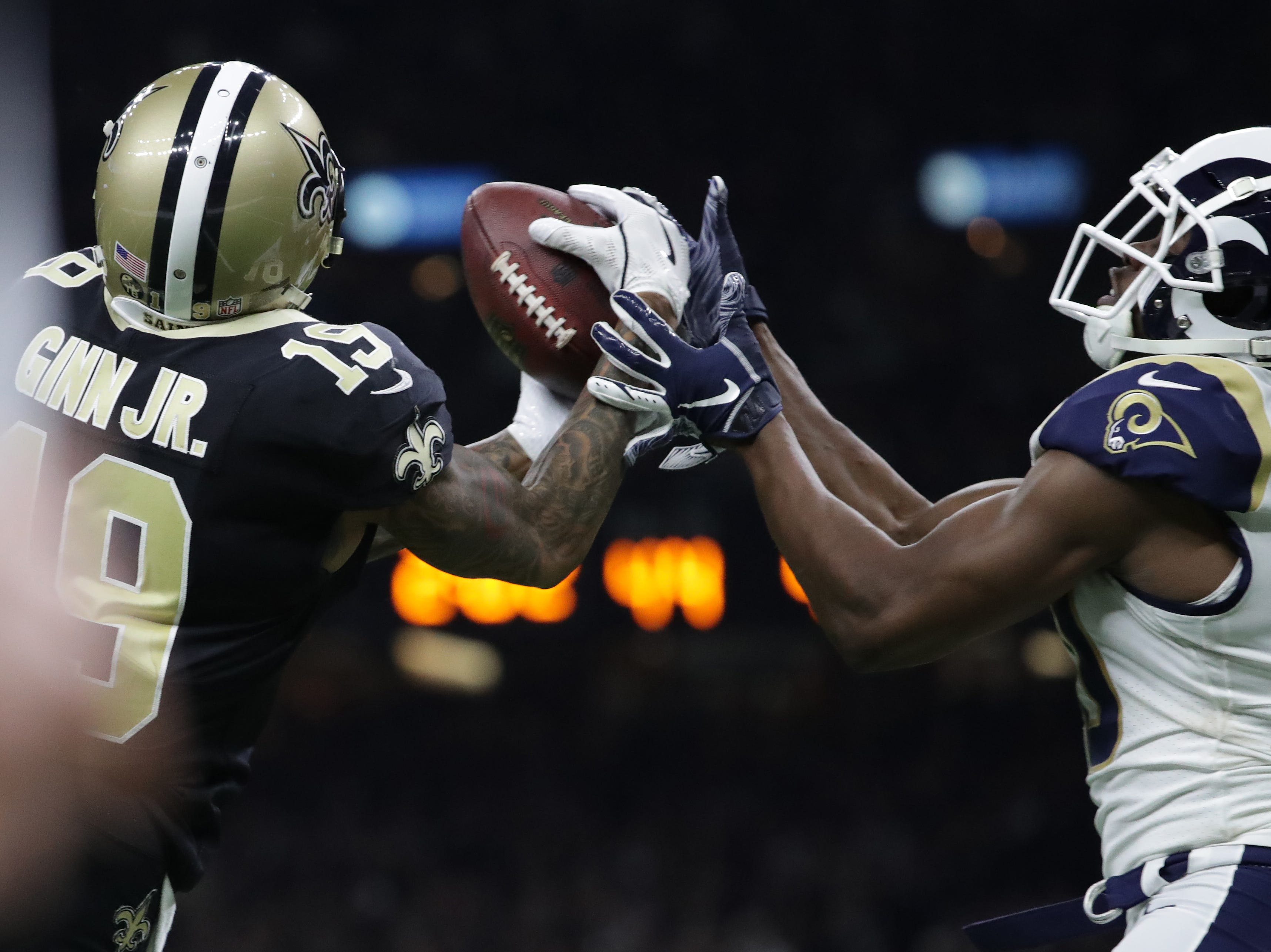 Jan 20, 2019; New Orleans, LA, USA; New Orleans Saints wide receiver Ted Ginn (19) catches a pass against Los Angeles Rams free safety Lamarcus Joyner (20) during the fourth quarter of the NFC Championship game at Mercedes-Benz Superdome. Mandatory Credit: Derick E. Hingle-USA TODAY Sports