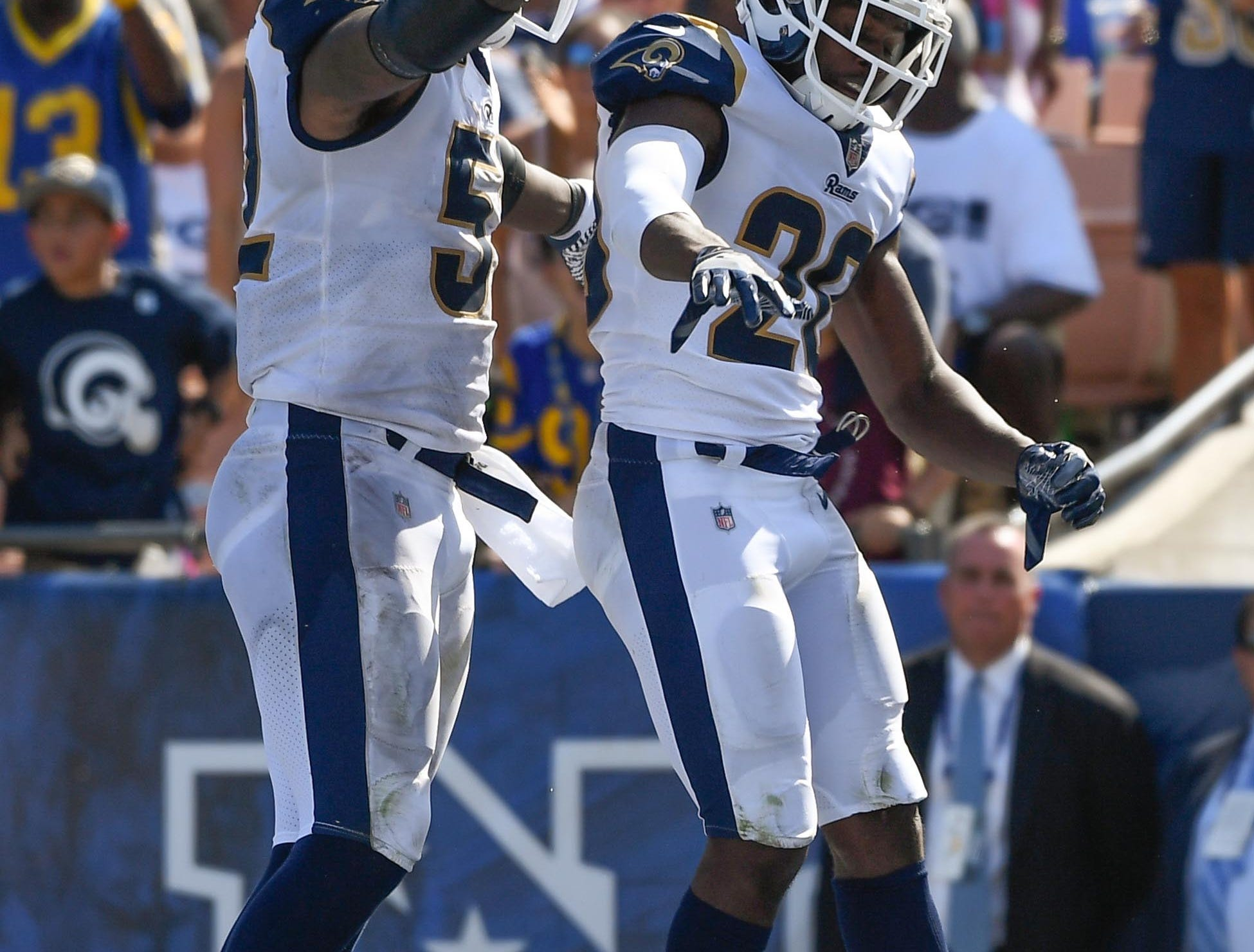 Sep 10, 2017; Los Angeles, CA, USA; Los Angeles Rams cornerback Lamarcus Joyner (20) celebrates running an interception back for a touchdown with teammate middle linebacker Alec Ogletree (52) during the third quarter at Los Angeles Memorial Coliseum. Mandatory Credit: Robert Hanashiro-USA TODAY Sports