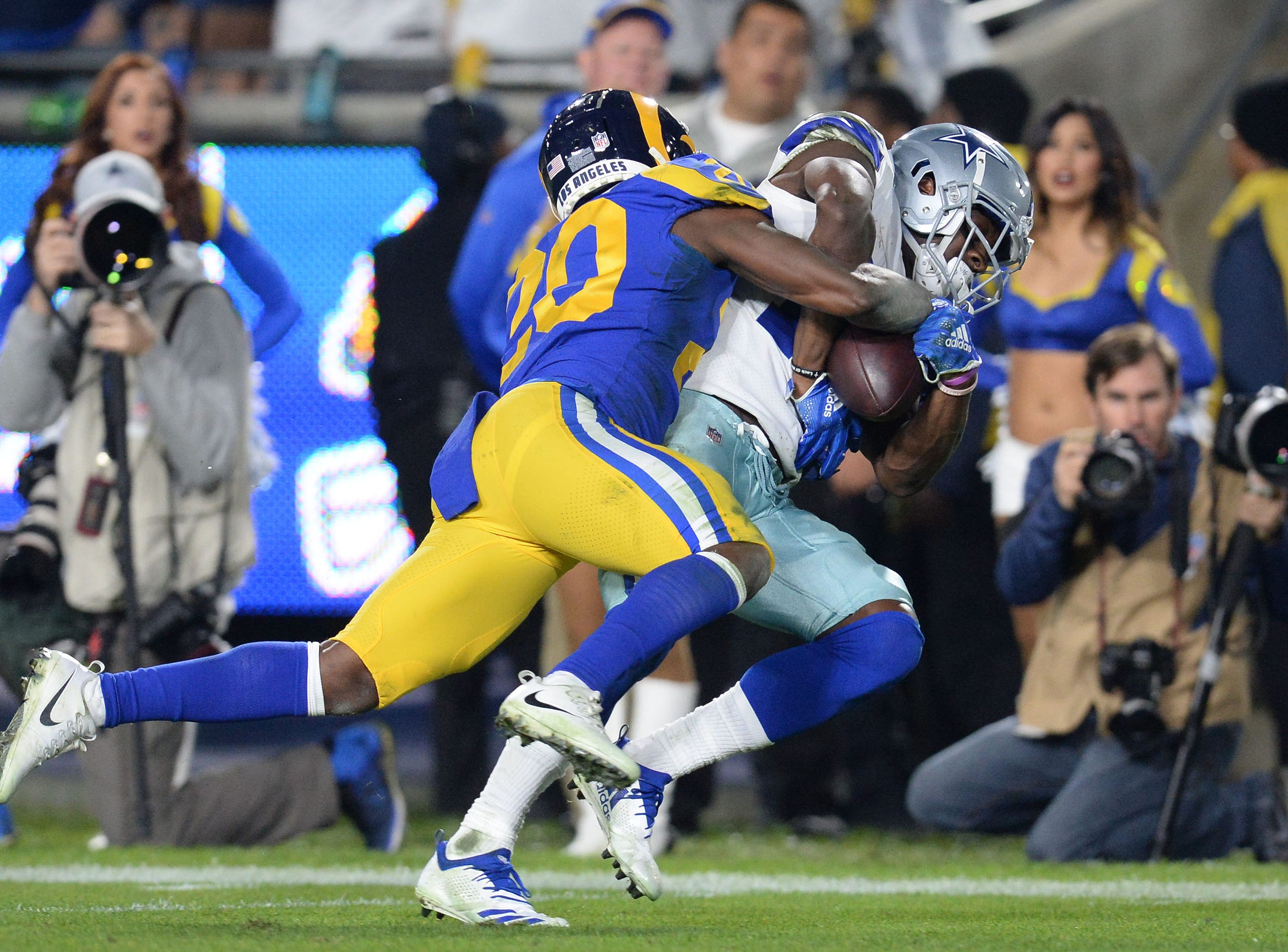 Jan 12, 2019; Los Angeles, CA, USA; Dallas Cowboys wide receiver Michael Gallup (13) makes a catch against Los Angeles Rams free safety Lamarcus Joyner (20) in the third quarter in a NFC Divisional playoff football game at Los Angeles Memorial Coliseum. Mandatory Credit: Gary A. Vasquez-USA TODAY Sports