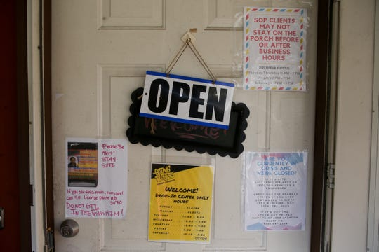 The door of the Capital City Youth Services drop-in center includes a notice warning clients against human trafficking. The drop-in center provides a safe space for youth aged 11 to 21 to work on goals, meet with counselors, do laundry and hang out.