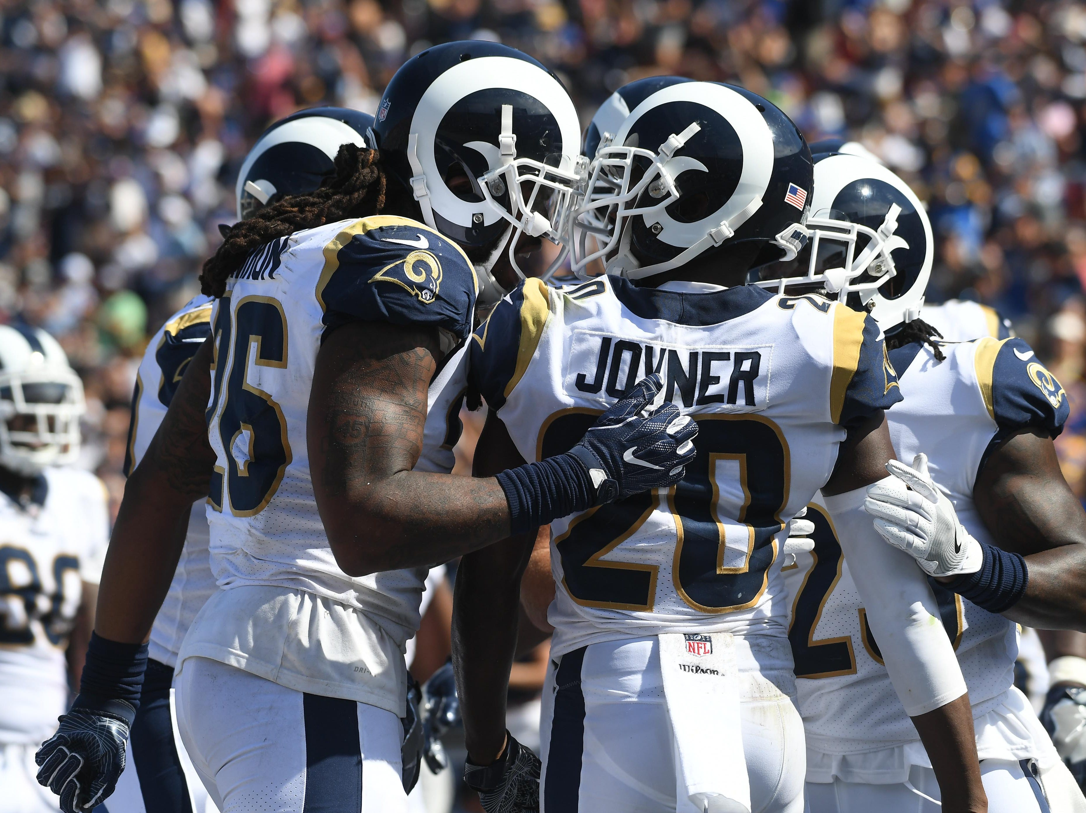 Sep 10, 2017; Los Angeles, CA, USA; Los Angeles Rams cornerback Lamarcus Joyner (20) celebrates with teammates after returning an interception for a touchdown against the Indianapolis Colts in the second half of a NFL football game at Los Angeles Memorial Coliseum. Mandatory Credit: Richard Mackson-USA TODAY Sports