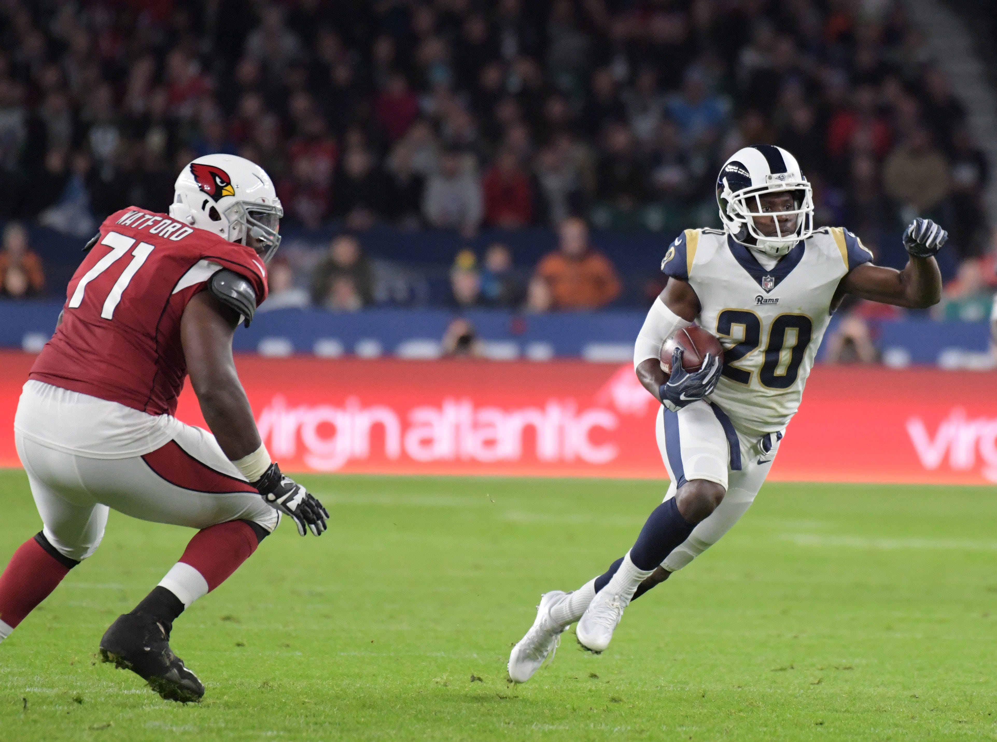 Oct 22, 2017; London, United Kingdom; Los Angeles Rams free safety Lamarcus Joyner (20) is defended by Arizona Cardinals offensive guard Earl Watford (71) on an interception return in the second quarter during an NFL International Series game at Twickenham Stadium. Mandatory Credit: Kirby Lee-USA TODAY Sports