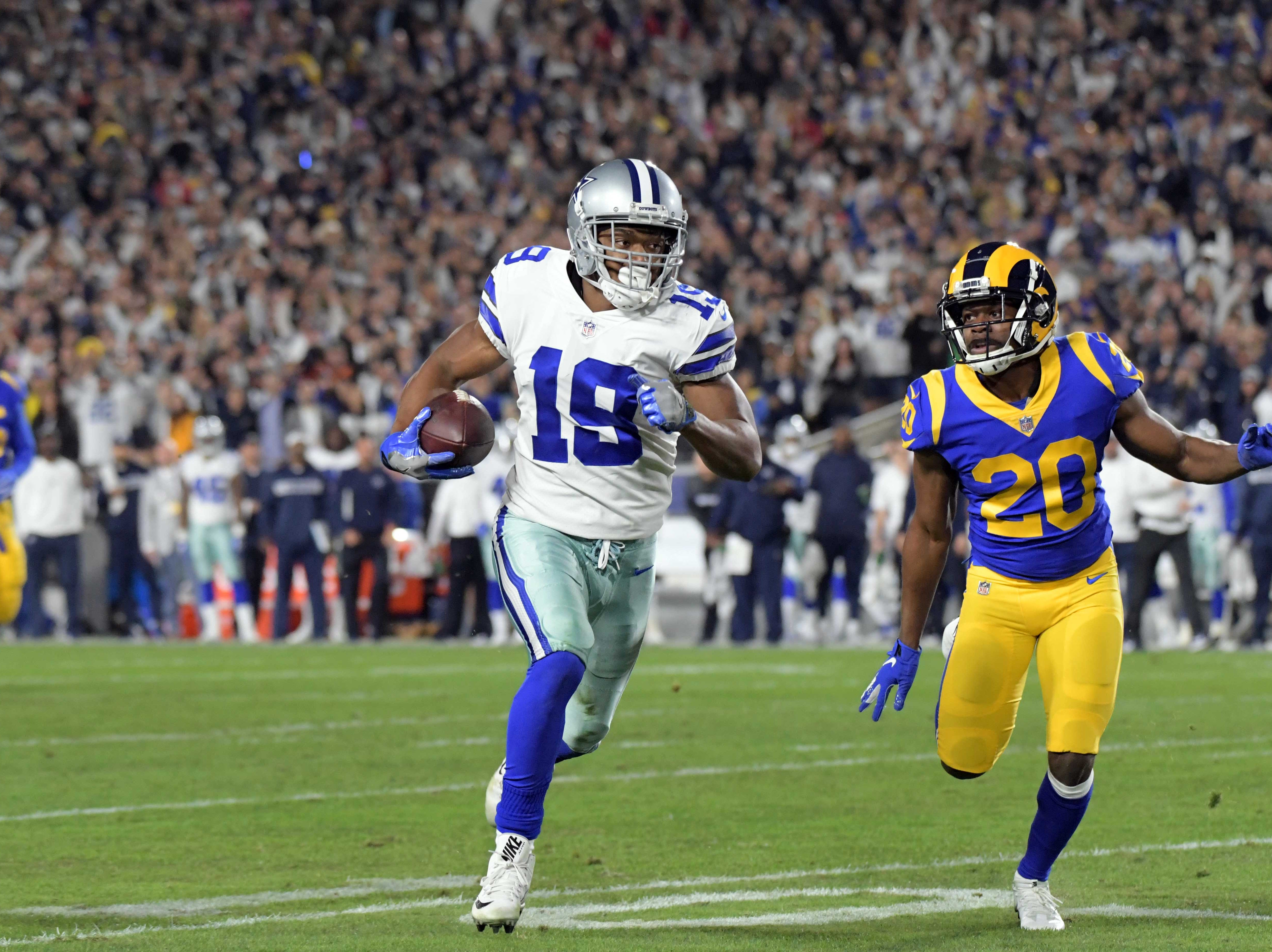 Jan 12, 2019; Los Angeles, CA, USA; Dallas Cowboys wide receiver Amari Cooper (19) runs the ball as Los Angeles Rams free safety Lamarcus Joyner (20) moves to defend during the first half in a NFC Divisional playoff football game at Los Angeles Memorial Coliseum. Mandatory Credit: Kirby Lee-USA TODAY Sports