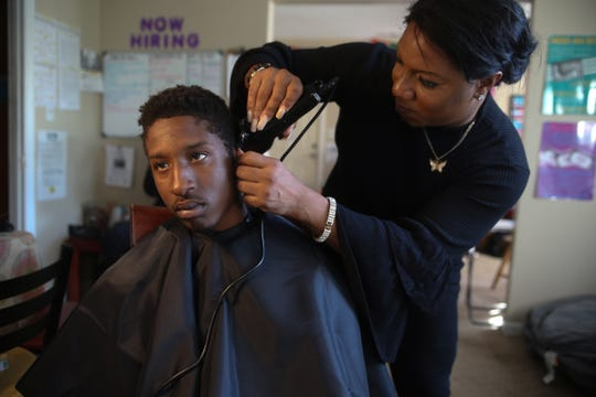 Lil Man, 19 gets his hair cut by Janel Diaz, a counselor at the Capital City Youth Services drop-in center Friday, Jan. 25, 2019. The drop-in center provides a safe space for youth aged 11 to 21 to work on goals, meet with counselors, do laundry and hang out.