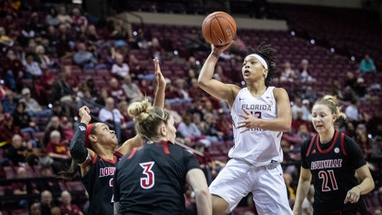 Florida State junior guard Nausia Woolfolk puts up a floater against Louisvile on January 24th, 2019.