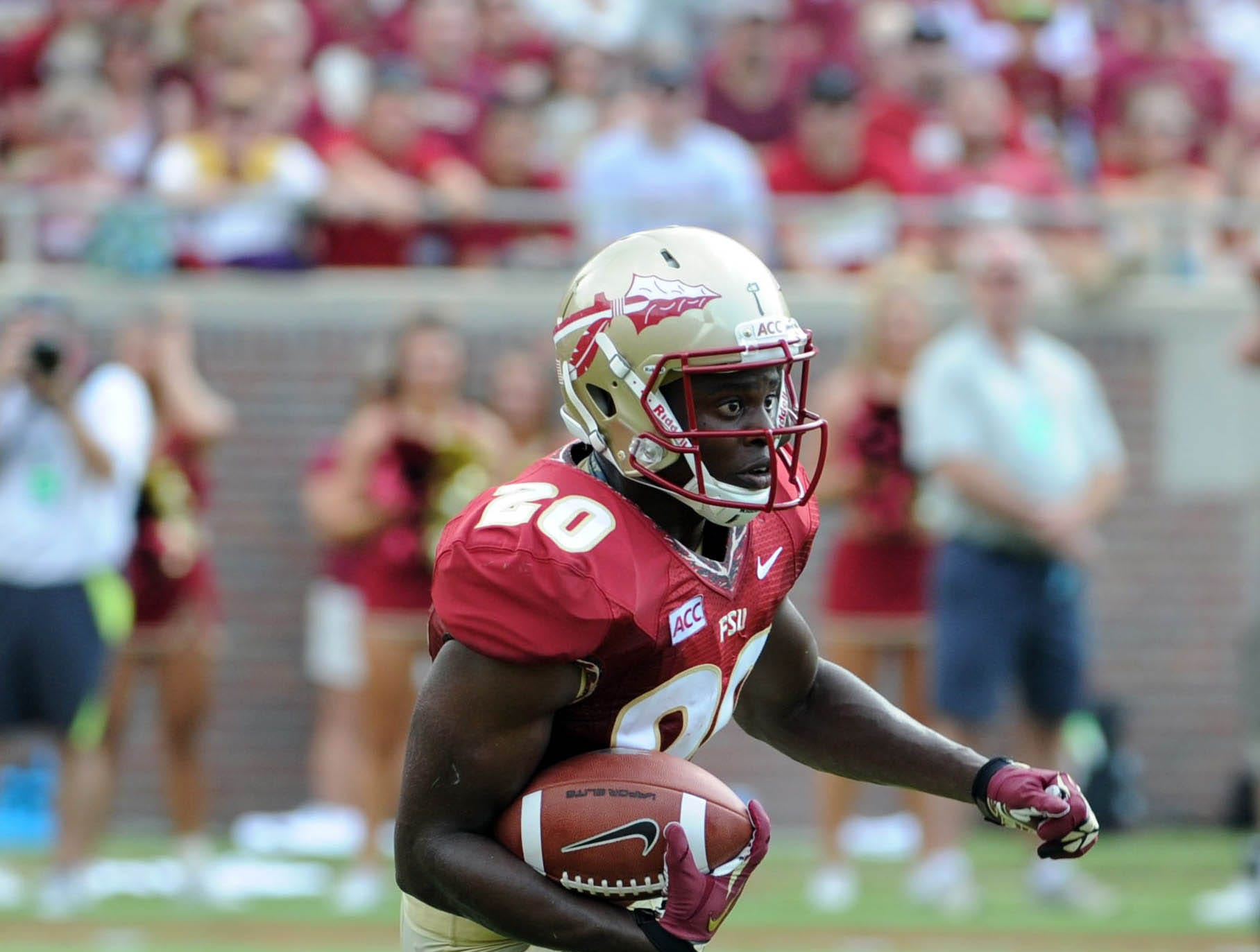 Sep 14, 2013; Tallahassee, FL, USA; Florida State Seminoles defensive back Lamarcus Joyner (20) runs the ball during the first half of the game against the Nevada Wolf Pack at Doak Campbell Stadium. Mandatory Credit: Melina Vastola-USA TODAY Sports