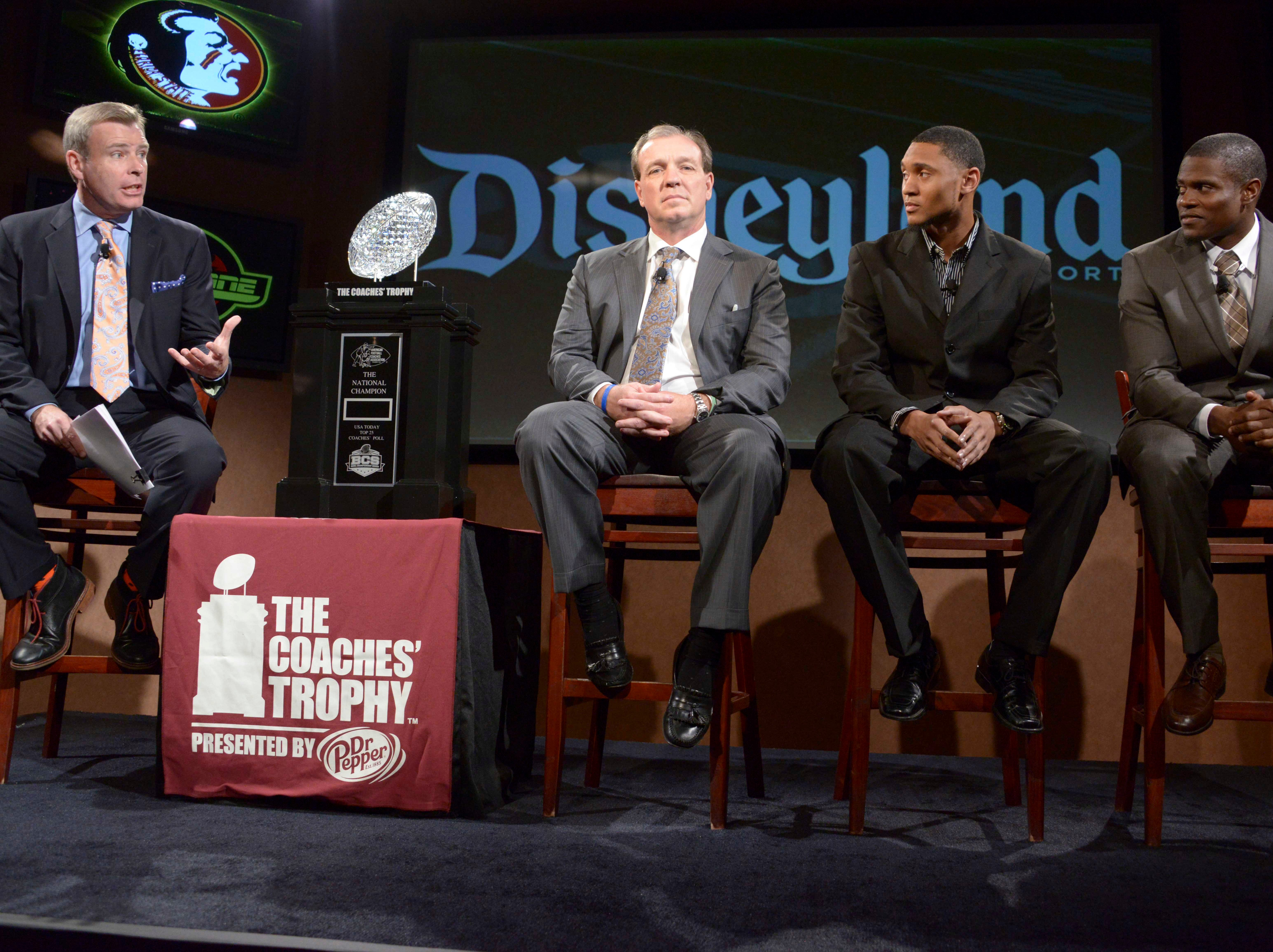 Dec 31, 2013; Anaheim, CA, USA; ESPN broadcaster Tom Rinaldi (left) interviews Florida State Seminoles coach Jimbo Fisher (second from left) and receiver Rashad Greene (second from right) and defensive back Lamarcus Joyner at a press conference for the 2014 BCS National Championship at ESPN Zone Downtown Disney. Mandatory Credit: Kirby Lee-USA TODAY Sports