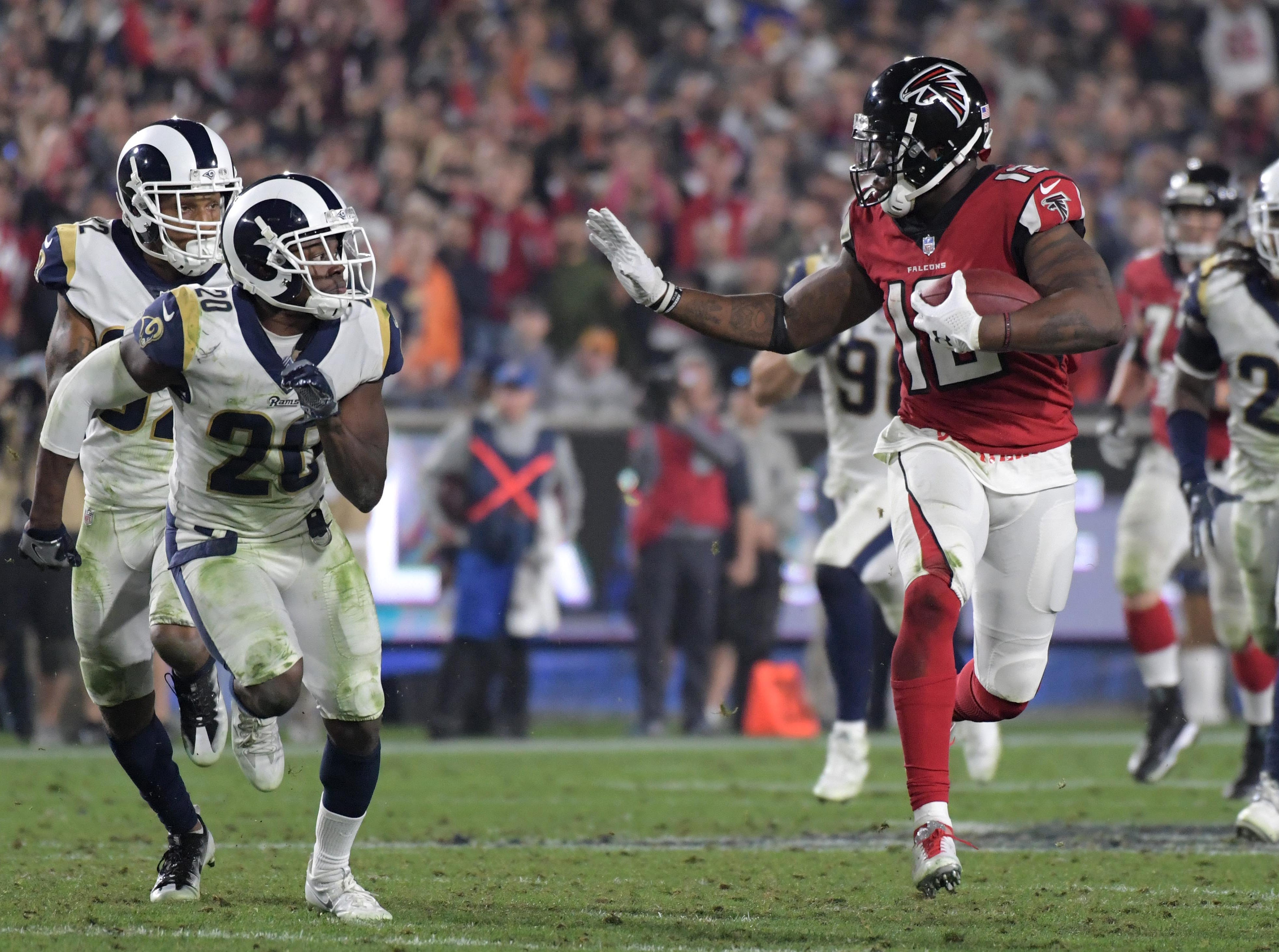 Jan 6, 2018; Los Angeles, CA, USA; Atlanta Falcons wide receiver Mohamed Sanu (12) runs against Los Angeles Rams free safety Lamarcus Joyner (20) in the fourth quarter in the NFC Wild Card playoff football game at Los Angeles Memorial Coliseum. Mandatory Credit: Kirby Lee-USA TODAY Sports
