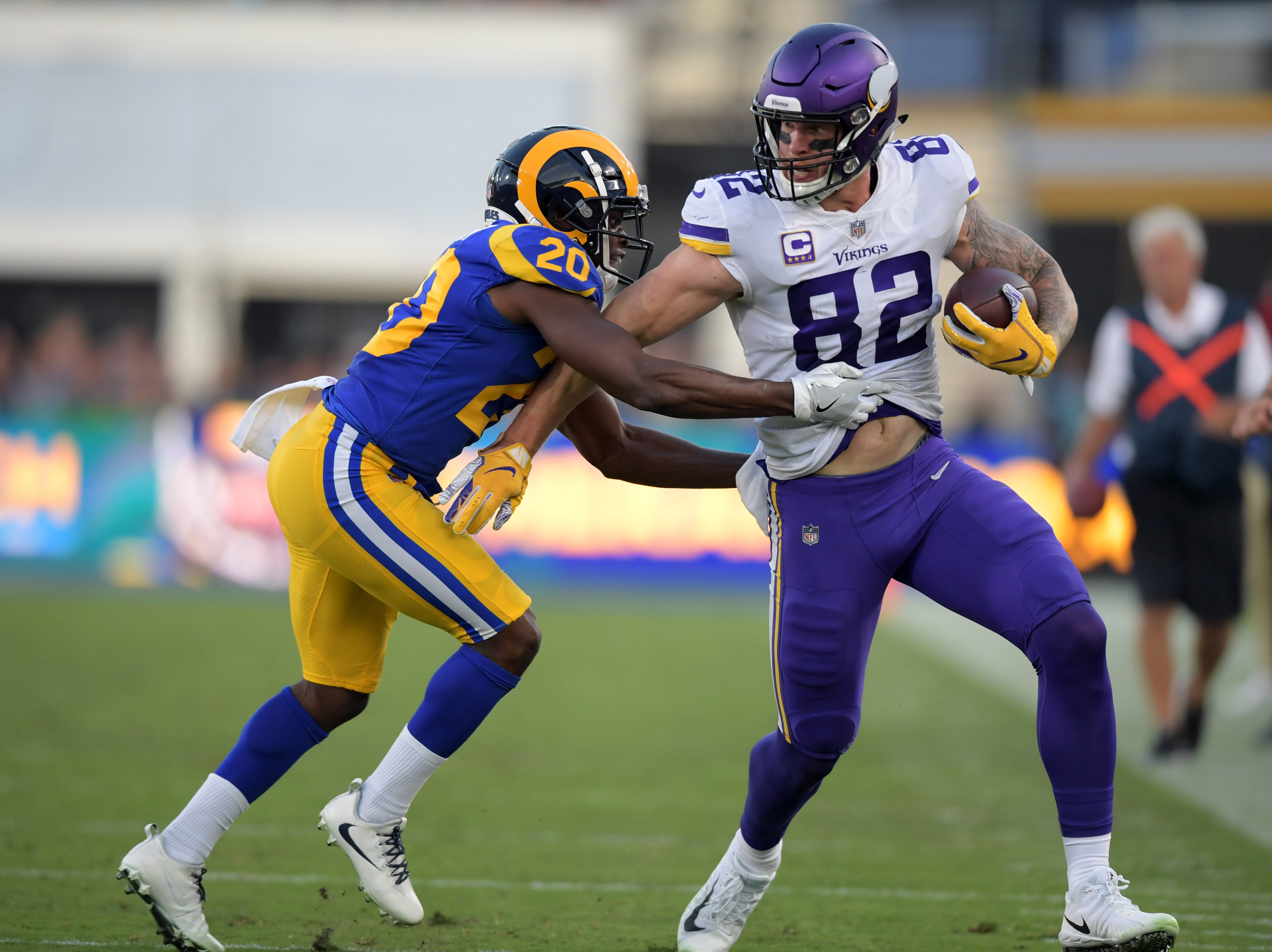 Sep 27, 2018; Los Angeles, CA, USA; Minnesota Vikings tight end Kyle Rudolph (82) runs with the ball as Los Angeles Rams defensive back Lamarcus Joyner (20) defends in the first quarter at Los Angeles Memorial Coliseum. Mandatory Credit: Kirby Lee-USA TODAY Sports