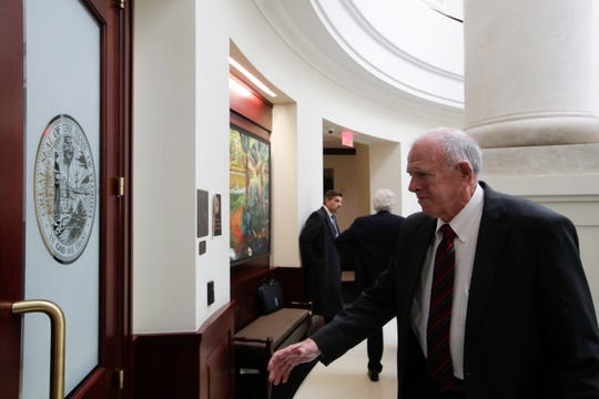 Former State Attorney and member of the Florida Commission on Ethics William Meggs enters the courtroom before the commission holds a probable cause hearing into an ethics complaint filed against former Mayor Andrew Gillum Friday, Jan. 25, 2019 at the First District Court of Appeals in Tallahassee.