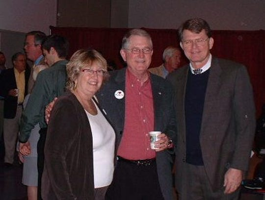 Tom Warner, right, is shown with Suzy Hutcheson of Helping People Succeed, left, and Barney Barnett, Vice Chairman of Publix Super Markets, in this file photo.