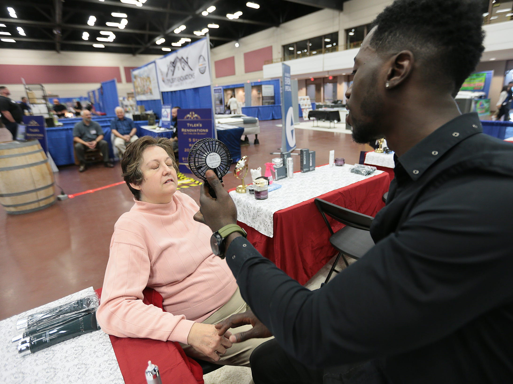 Femi Olanrewaju demonstrates Bionyx, an anti-aging product, at the El Paso Spring Home Show and Pet Expo Friday. The show continues Saturday 10-7pm and Sunday 11-4pm.