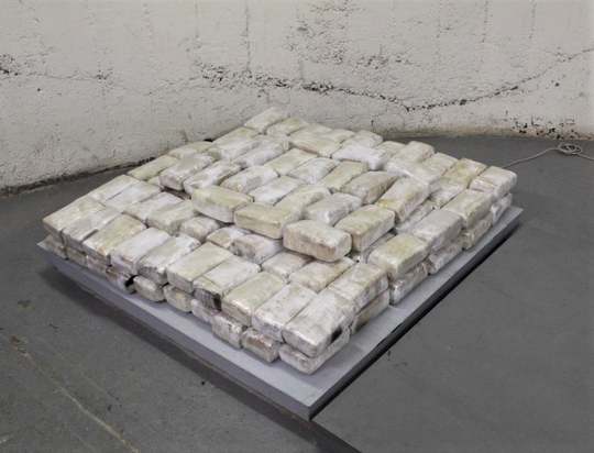 Police found 140 bundles of wrapped marijuana that weighed a total of 157.3 pounds Wednesday at a home in the 800 block of North Grama Street.