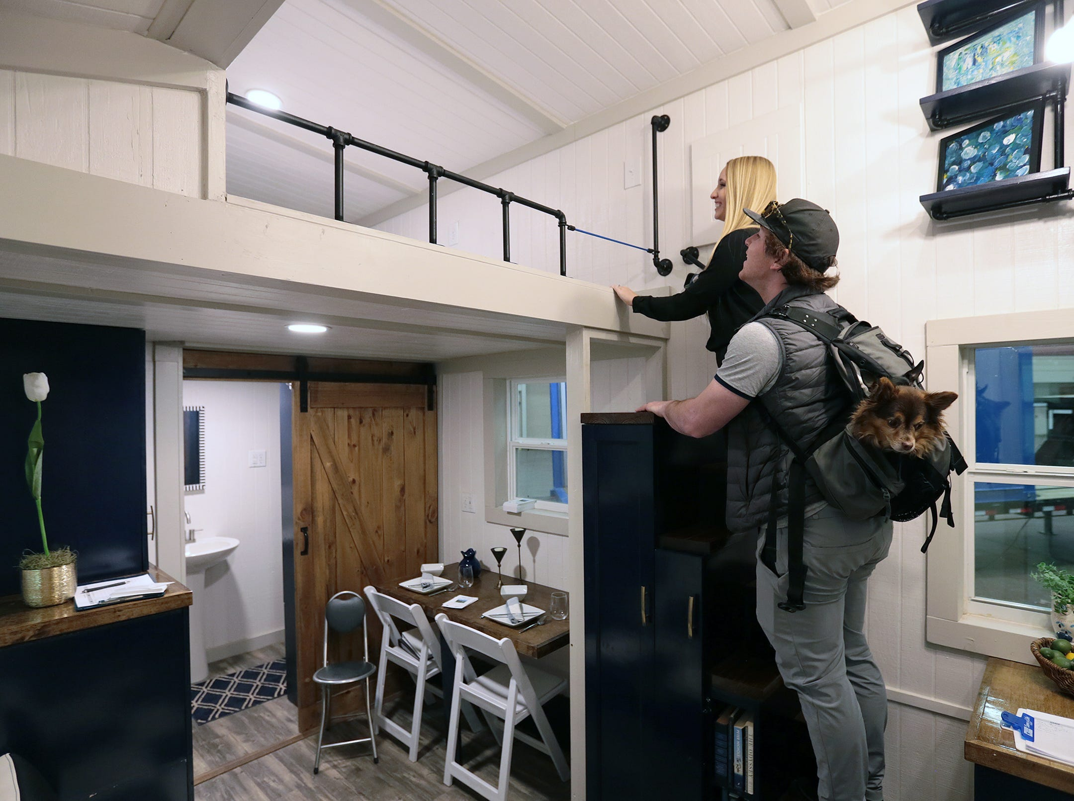 A couple tours a tiny home by Triangle D Tiny homes at the El Paso Spring Home Show and Pet Expo Friday. The show continues Saturday 10-7pm and Sunday 11-4pm.