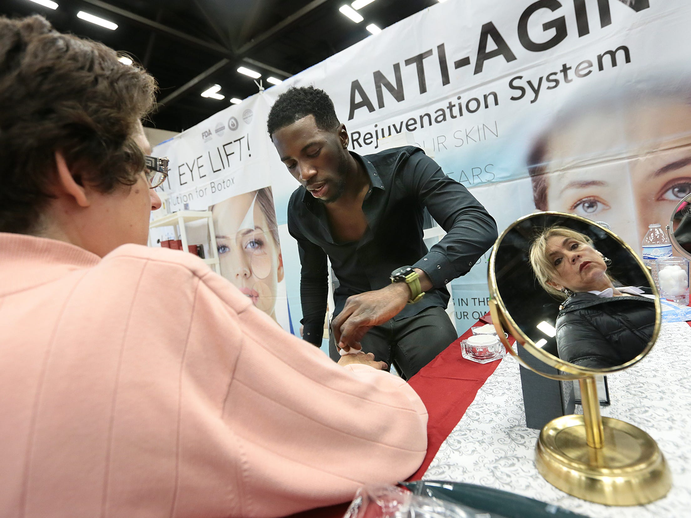 Femi Olanrewaju demonstrates Bionyx, an anti-aging product, at the El Paso Spring Home Show and Pet Expo on Friday. The show ran through Saturday  and Sunday.