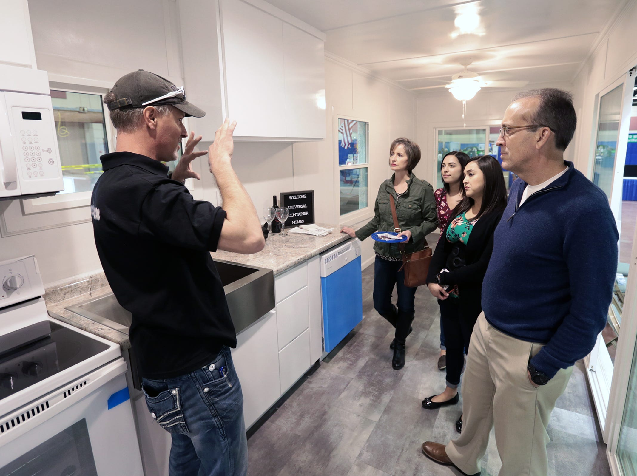Les Burk of Universal Container Homes Manufacturing gives a tour of a model home at the El Paso Spring Home Show and Pet Expo Friday. The show continues Saturday 10-7pm and Sunday 11-4pm.