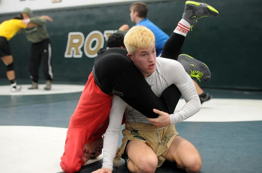 Jacob Hansen practices his wrestling moves with teammate Arshag Dadourian  at Royal High on Thursday.