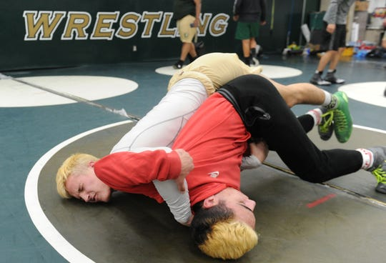 Jacob Hansen, left, and Arshag Dadourian do battle during Royal's wrestling team practice. Royal High will host the CIF-SS Division 4 Dual Meet Championships on Saturday.