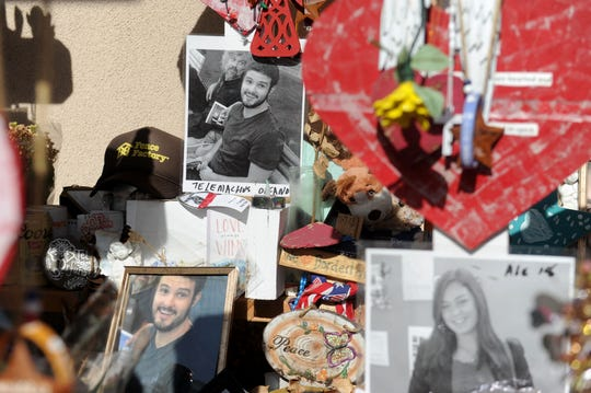 Photos of Telemachus Orfanos and other victims adorn a memorial to the Borderline Bar & Grill shooting on Nov. 7.