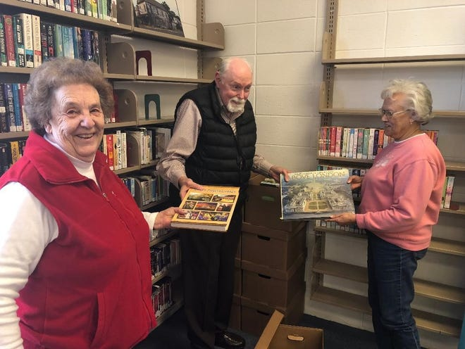 Friends of Bridgeton Library members (from left) Dorothy Simons, John Simons and Yvonne Custis prepare for the upcoming used book and jewelry, which begins on Feb. 2.