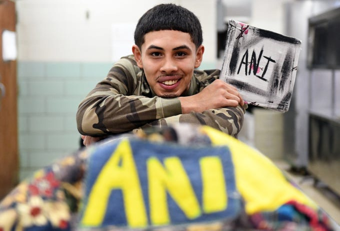 Fabricio Lobo, 20, designs and sells clothing branded as ANI pictured here at Cunningham Academy in Vineland on Thursday, Jan. 24, 2019.