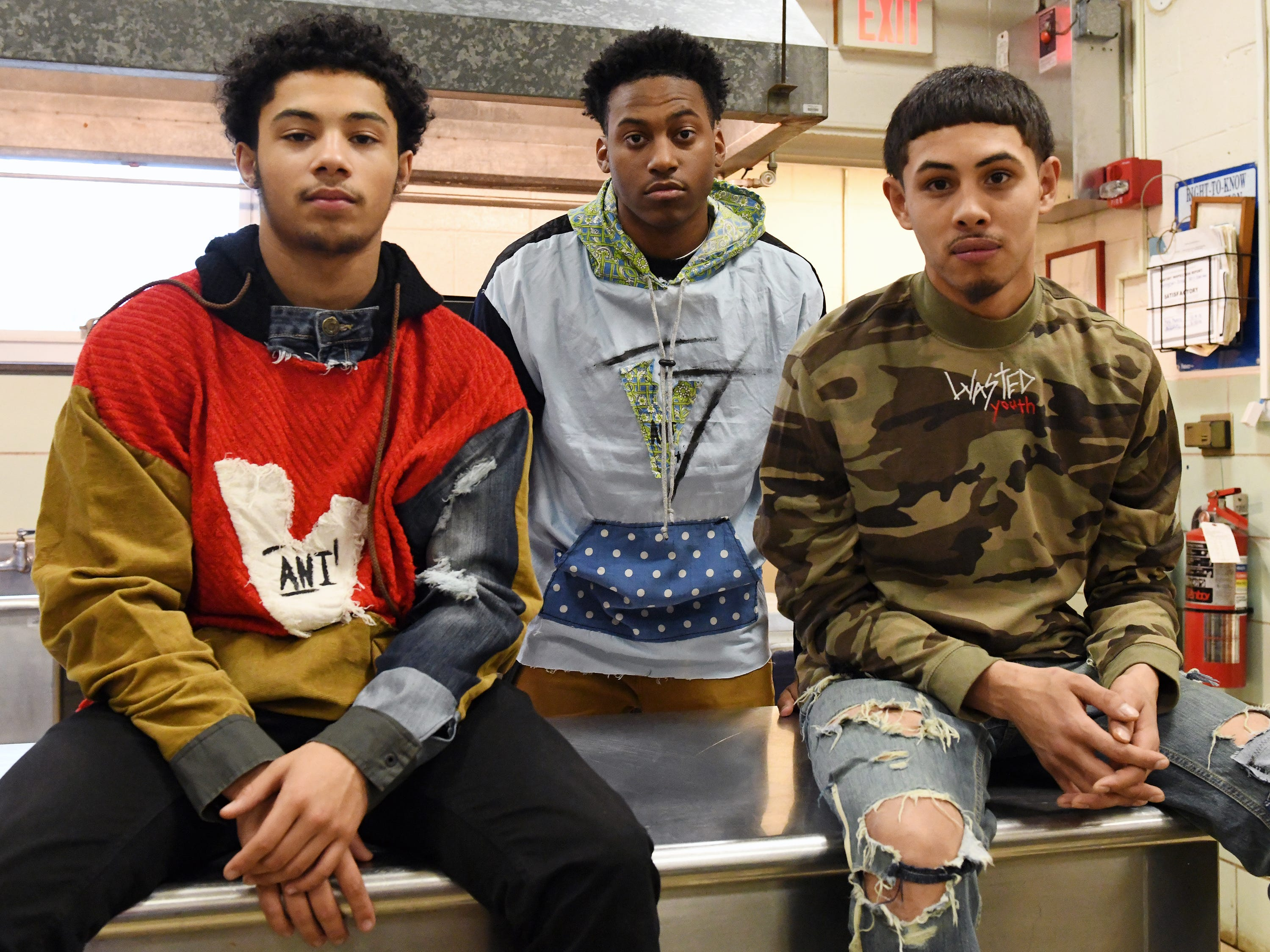 Fabricio Lobo (right) shows off some of his fashion line with his friends Cameron Purnell (center) and Zae Bogan at Cunningham Academy in Vineland on Thursday, Jan. 24, 2019.