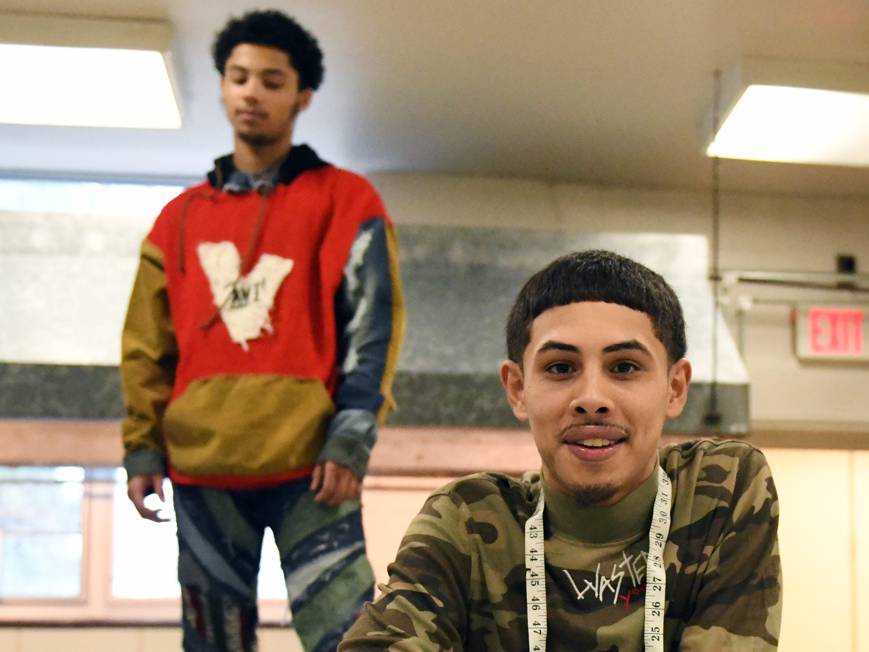Fabricio Lobo, a Cunningham Academy student in Vineland, makes and sells his own clothing line called ANI. His friend Zae Bogan helps show off some of Lobo's designs at Cunningham Academy in Vineland on Thursday, Jan. 24, 2019