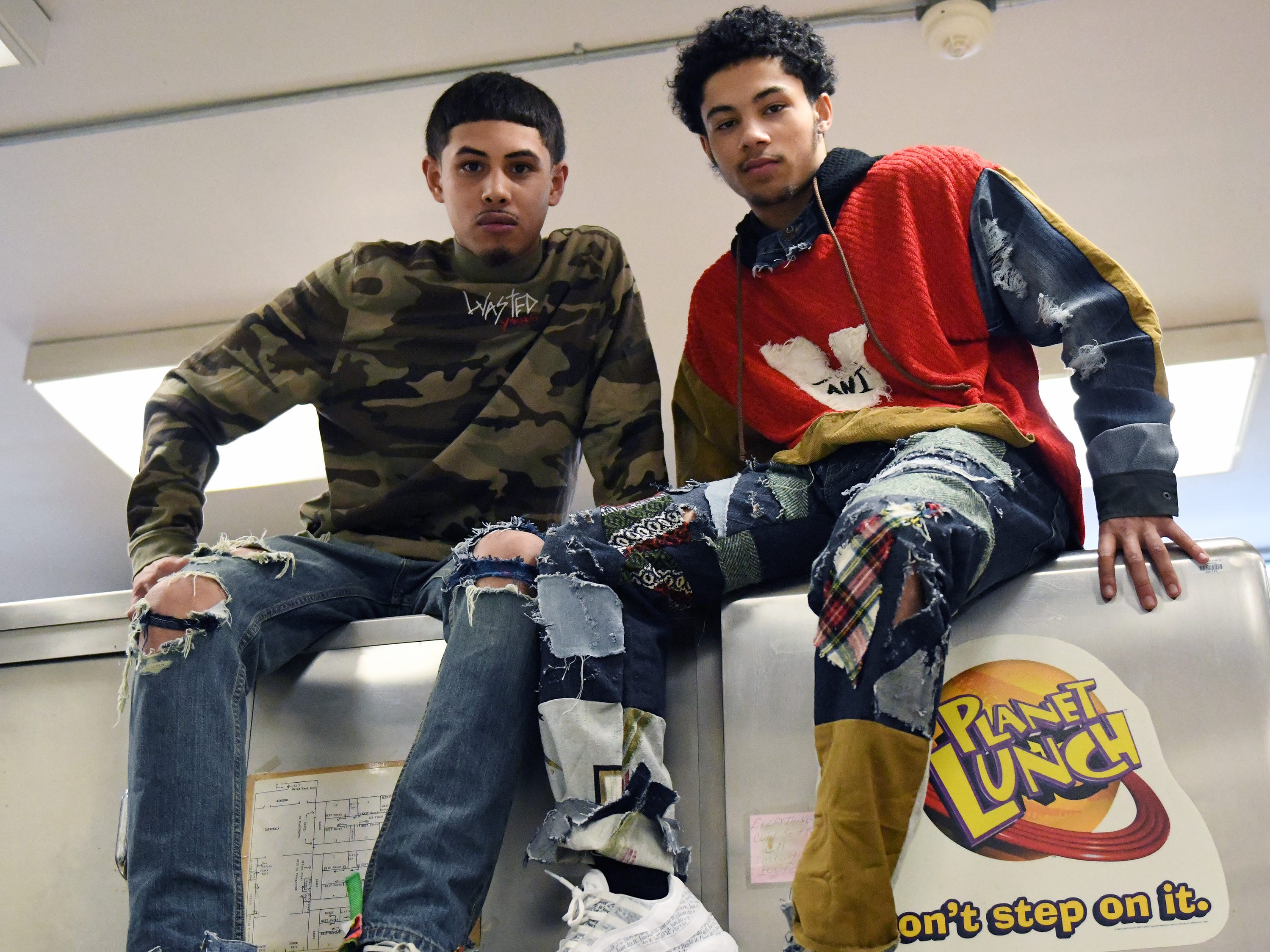 Fabricio Lobo (left) shows off some of his fashion line with his friend Zae Bogan at Cunningham Academy in Vineland on Thursday, Jan. 24, 2019.