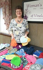 Barbara Robinson, a member of the Woman's Club of Vineland, is pictured with a collection of winter accessories, which the club recently donated to the Saint Vincent de Paul clothing center.