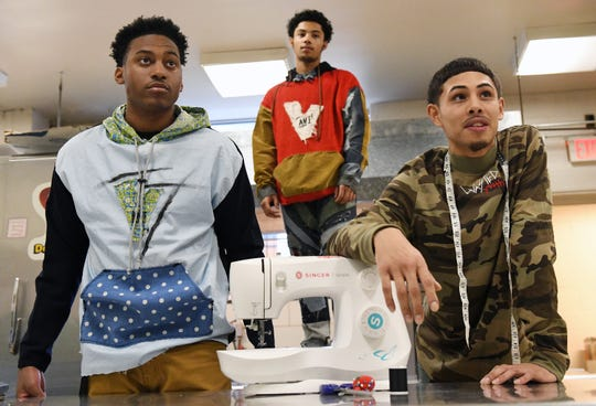 Fabricio Lobo (right) shows off some of his fashion line with his friends Cameron Purnell (left) and Zae Bogan at Cunningham Academy in Vineland on Thursday, Jan. 24, 2019