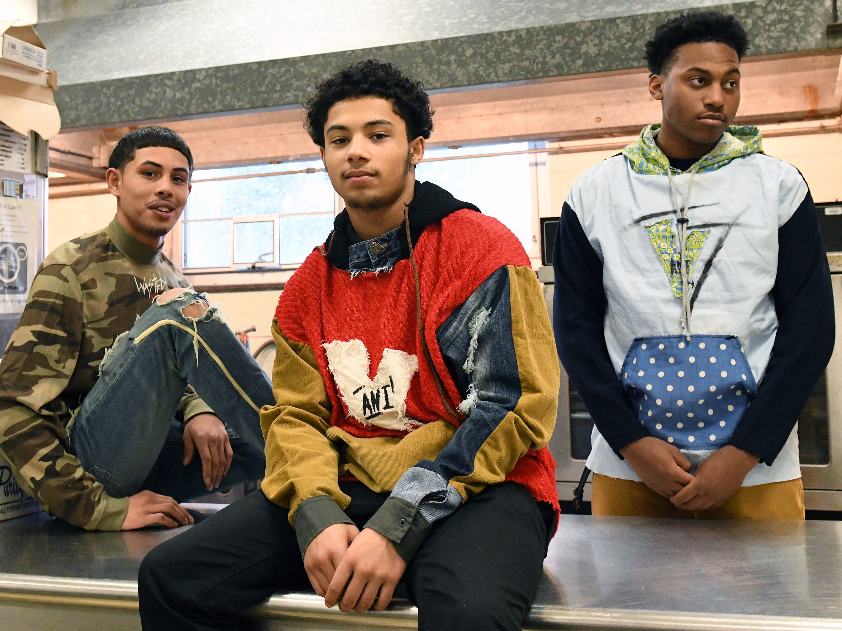 Fabricio Lobo (left) shows off some of his fashion line with his friends Zae Bogan (center) and Cameron Purnell at Cunningham Academy in Vineland on Thursday, Jan. 24, 2019