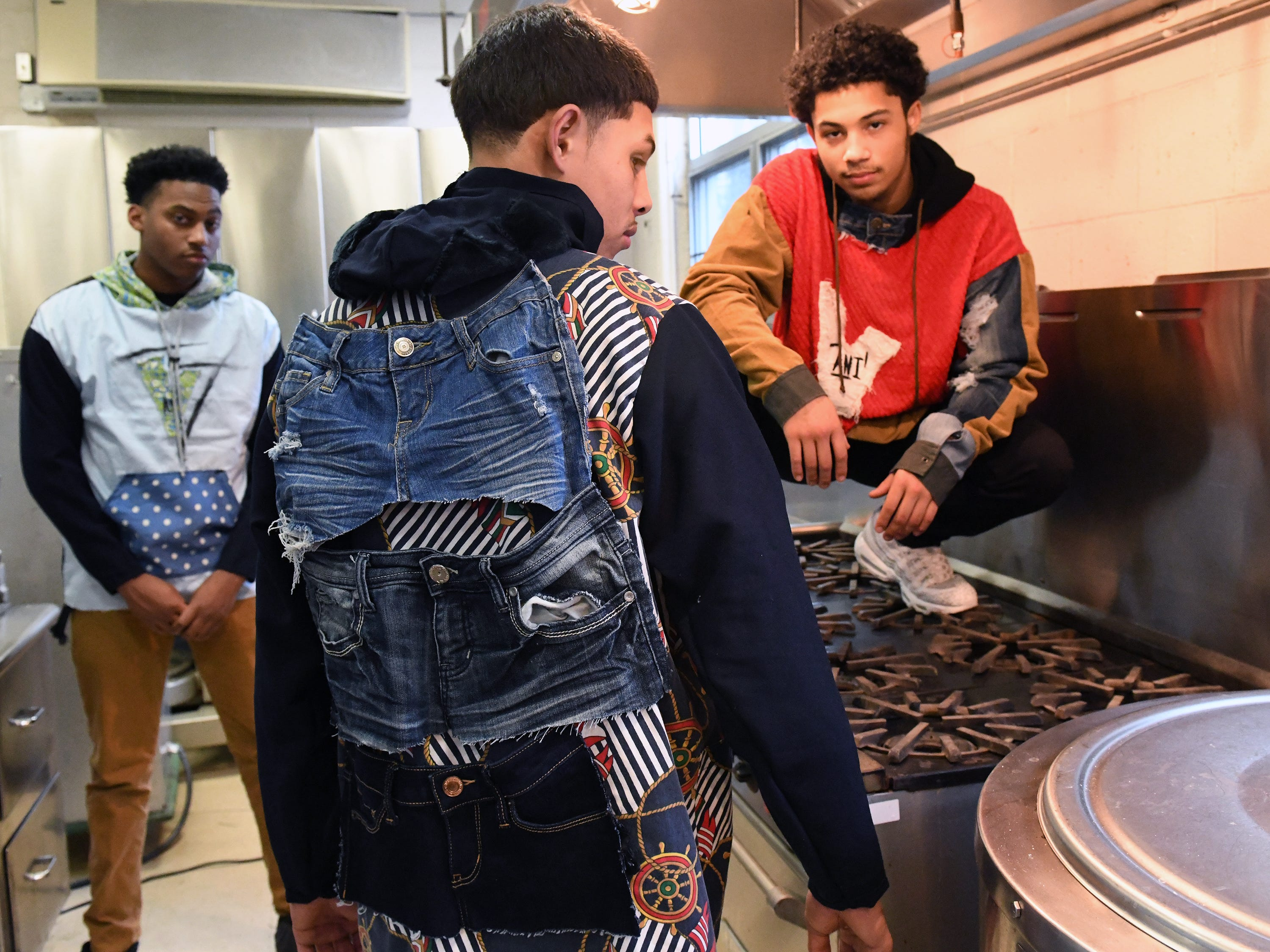 Fabricio Lobo (center) shows off some of his fashion line with the help from friends Cameron Purnell (left) and Zae Bogan at Cunningham Academy in Vineland on Thursday, Jan. 24, 2019