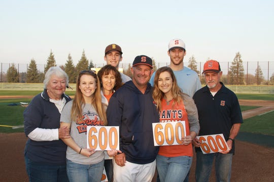 The Allen family poses for a photo after COS baseball head coach Jody Allen eclipsed the 600-win mark in 2018.