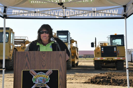 """Visalia Parks and Recreation Department Director Jeannie Greenwood celebrates """"21 years of planning and development"""" at the ground-breaking ceremony of Riverway Sports Park's final phase of construction. Set to finish in 2020, the  site will host a premiere softball complex, expanded parking lot and picnic arbor."""