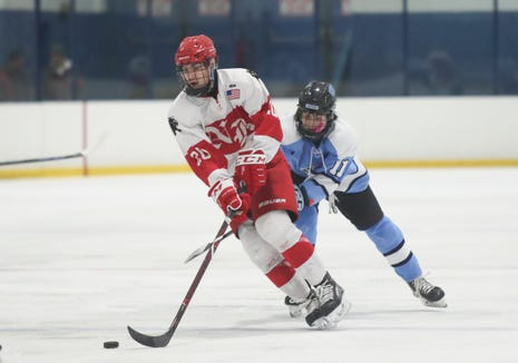 North Rockland forward Luke Morris (20) skates the puck during varsity ice hockey action at Sport-O-Rama Ice Rink in Monsey on Friday, January 25, 2019.