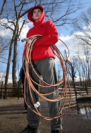 Zachary Kuttruf stands with the extension cord that was used to save a man that had fallen through the ice on Lake Oscawana in Putnam Valley on Weds evening. Kuttruf, a 14-year old boy scout directed first responders to the scene where a man riding an atv had fallen through the ice.