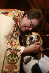 The Rev. Susan Fortunato blesses Zoe, a beagle, at St. Stephen's Episcopal Church in Pearl River during the The Blessing of the Animals service on Oct. 3, 2010.