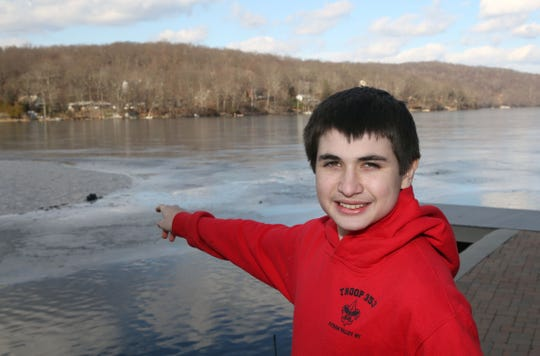 Zachary Kuttruf talks about the ice rescue that took place on Lake Oscawana in Putnam Valley on Weds evening, while standing on the shore of the lake Jan. 25, 2019. Kuttruf, a 14-year old boy scout, directed first responders to the scene where a man riding an atv had fallen through the ice.