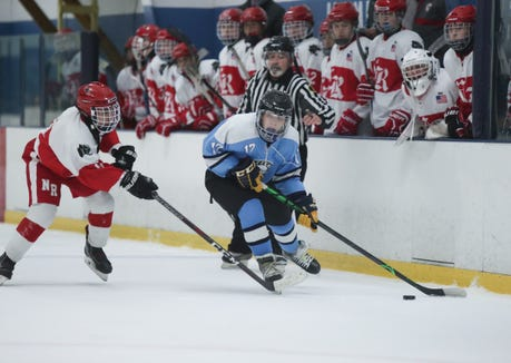 Suffern forward Ben Burns (17) skates the puck past the North Rockland bench during varsity ice hockey action at Sport-O-Rama Ice Rink in Monsey on Friday, January 25, 2019.