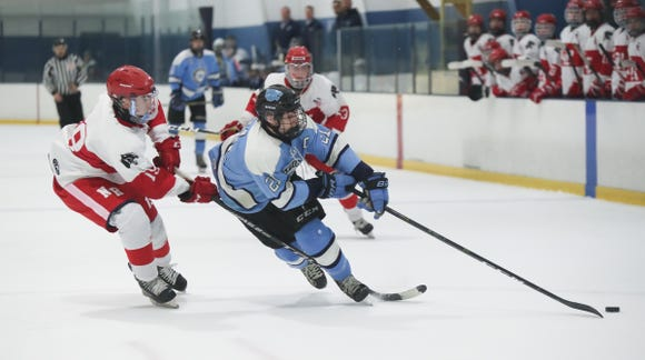 North Rockland forward Aiden Grange (19) trips Suffern forward Kyle Foresta (21) during varsity ice hockey action at Sport-O-Rama Ice Rink in Monsey on Friday, January 25, 2019.