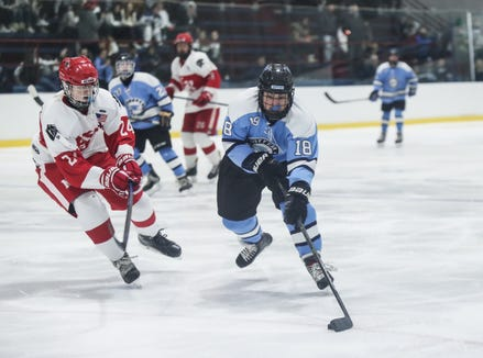 Suffern forward Ben Katz (18) works the puck past North Rockland defenseman Tim O'Connor (24) during varsity ice hockey action at Sport-O-Rama Ice Rink in Monsey on Friday, January 25, 2019.