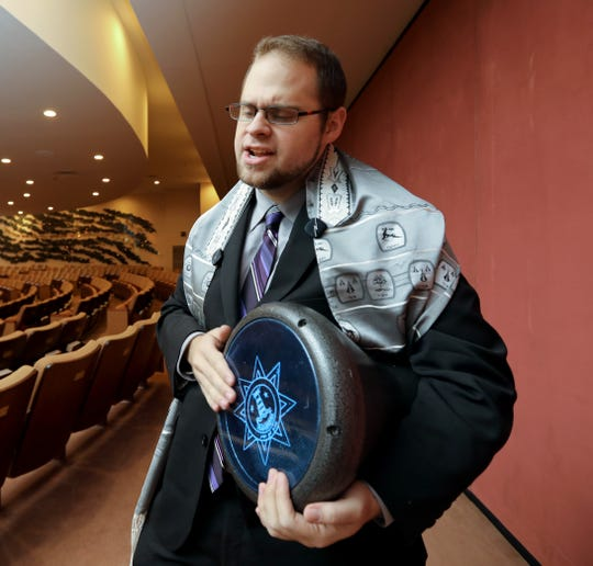 Jacob Sandler sings with his drum at the New City Jewish Center Jan. 25, 2019. He is interning there while a studying at the Jewish Theological Seminary in New York City.