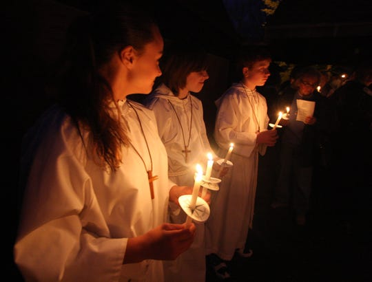Altar servers hold candles during the Great Vigil of Easter at St. Stephen's Episcopal Church in Pearl River April 11, 2009. ( Peter Carr / The Journal News )