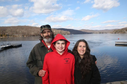 Bruce, Zachary, and Jennifer Kuttruf, talk about the ice rescue that they all assisted in on Lake Oscawana in Putnam Valley on Weds evening, while standing on the shore of the lake Jan. 25, 2019. A man riding an atv had fallen through the ice.