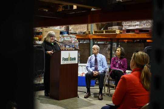 Patricia Beebe, CEO of the Food Bank of Delaware speaks at press conference at the Milford location about passing out food to government workers affected by the shutdown.