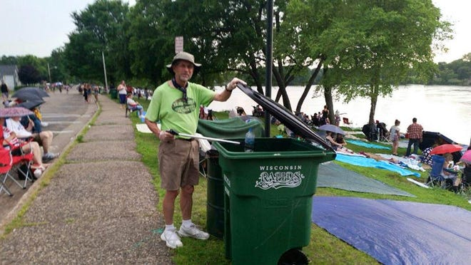 Joe Ancel puts recyclables in the proper bins in downtown Wisconsin Rapids on the Fourth of July.